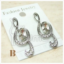 Music Gold / Silver Treble Clef Diamond Earrings