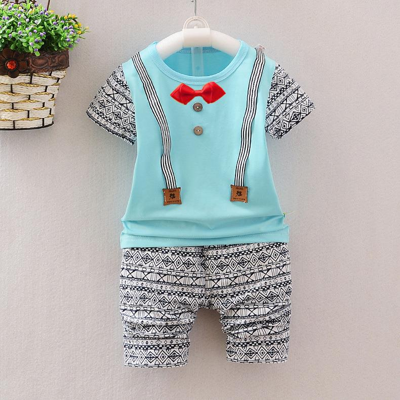 64a111882 00314 Short Sleeves Bowknot With Strap Design Baby Kids Clothing Set. ‹ ›