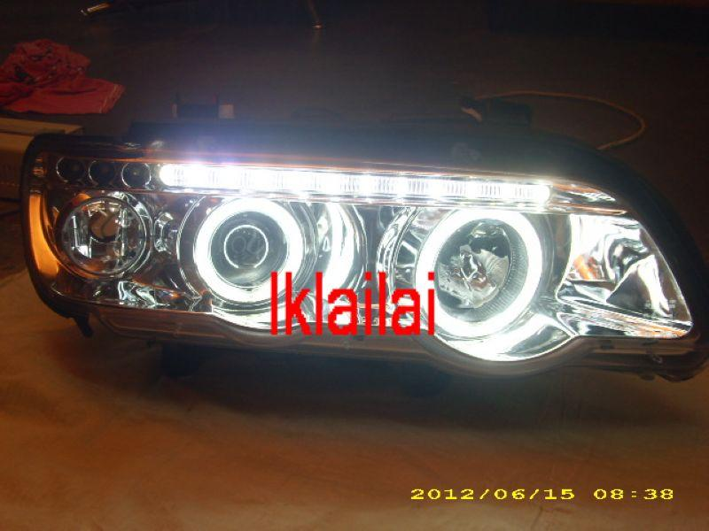 BMW X5 E53 Projector Head Lamp CCFL Ring & LED Eye Brown