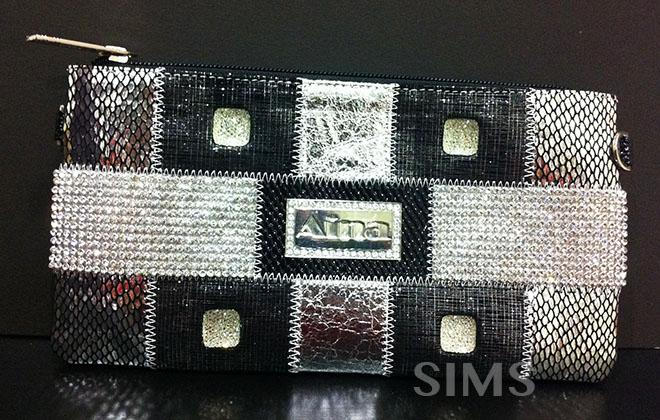 Designer Wristlet,Clutch,Bag,Pouch with bling bling rhinestones, black..