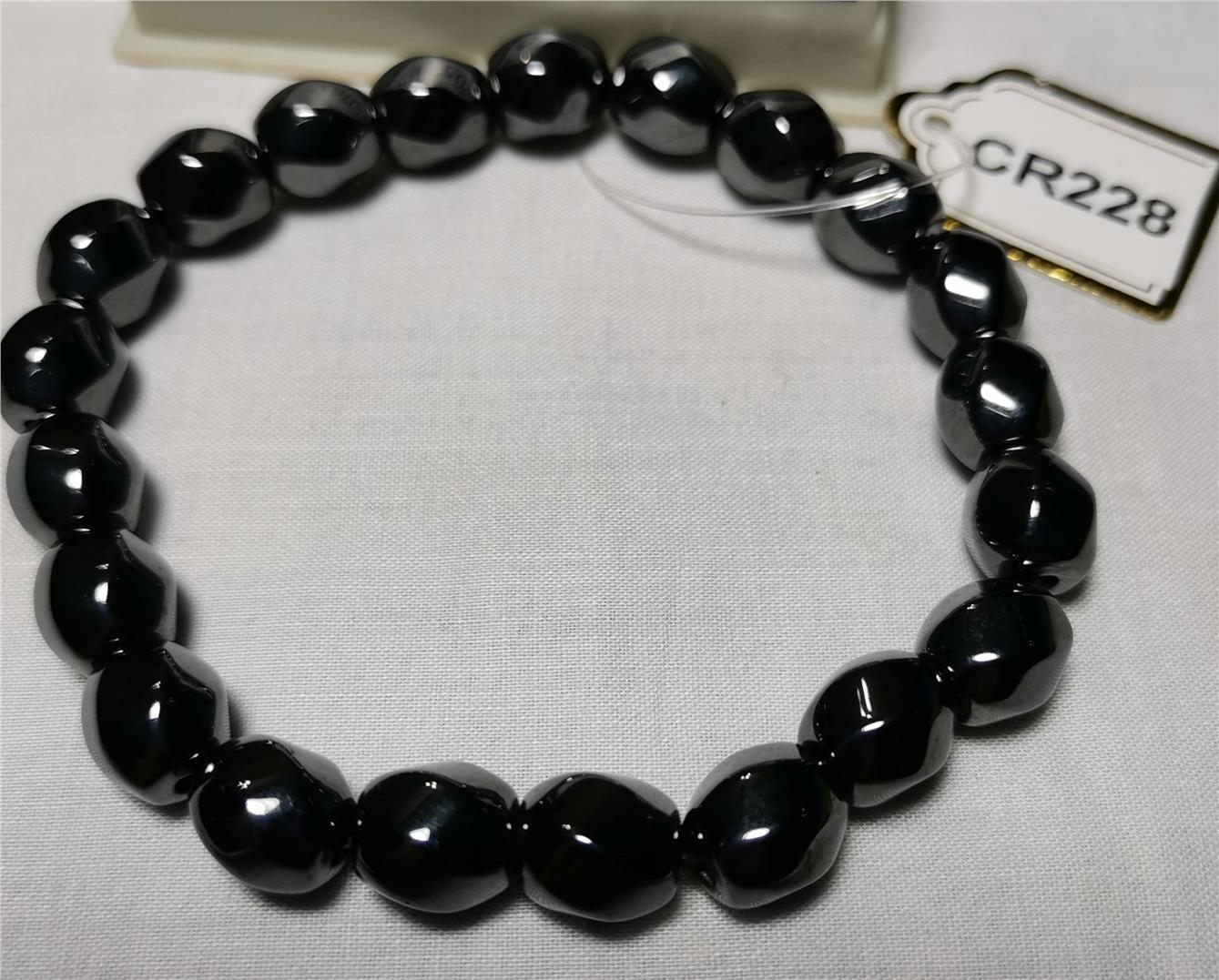 Hematite Faceted S-Shape (8mm)