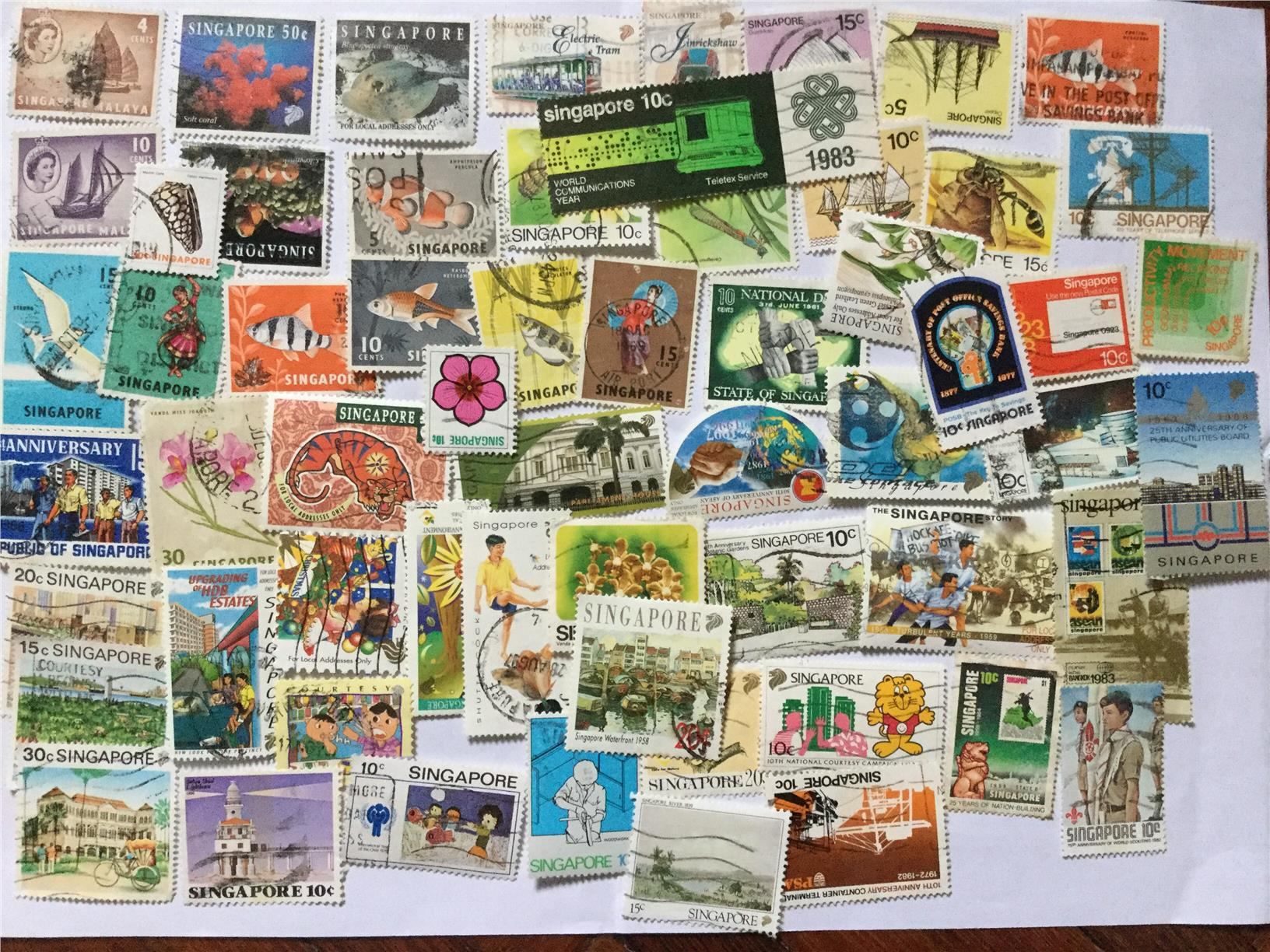 Singapore Approximately 60 Nice Stamps